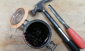 A jar of jam, a hammer and a chisel