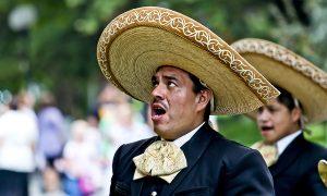 Man in sombrero singing